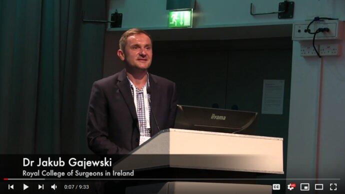 European man speaking at a lectern