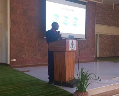 Dr. Xavier Nsabagasani, PERFORM2Scale Coordinator in Uganda, making a presentation on the country's progress (MSI and NSSG)