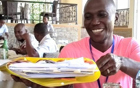 One of the Nakaseke team members has packed his plan to take back to the district